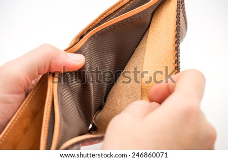 Isolated empty brown leather wallet / purse with no money on white background  - stock photo