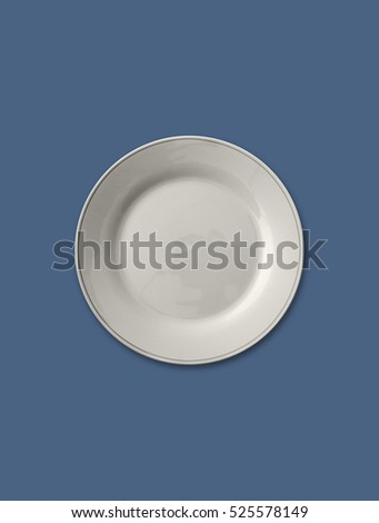 Isolated empty plate on solid gray blue color background