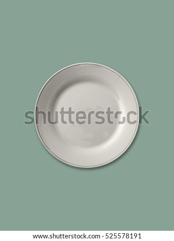 Isolated empty plate on solid mint color background