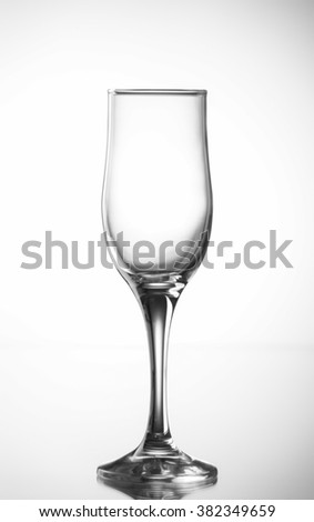 Isolated empty wineglass on a white background.