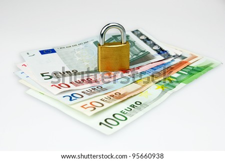 isolated euro currency money with lock - stock photo