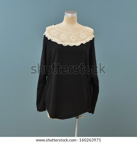 Isolated fashion clothes on female mannequin-blue background