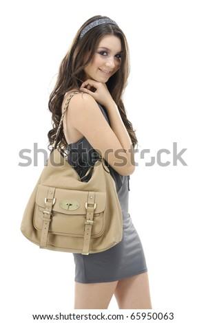 isolated fashionable young woman with handbag - stock photo