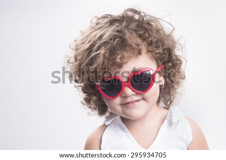 Isolated female child with red sun glasses