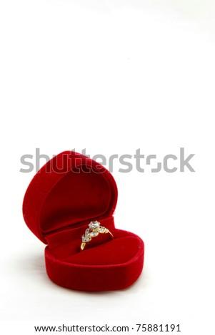 isolated female diamond ring in red velvet box - stock photo