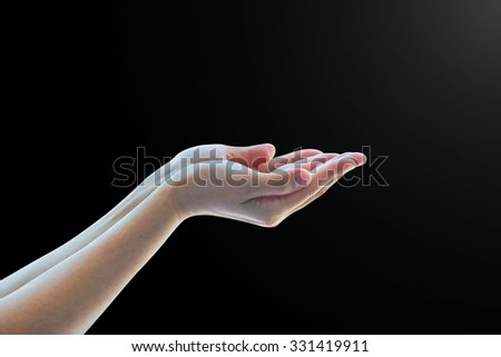 Isolated female empty open woman hand with palm raised upward in black and white dark color tone with rim light: Pray for help, hope, spiritual support: Humanitarian aid and human rights concept  - stock photo