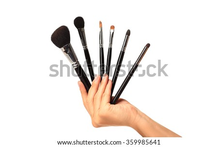 isolated female hand with a brushs for makeup