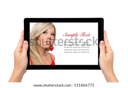 isolated female hands hold longer banner computer tablet with a beautiful blonde sexy girl and a strawberry on the screen - stock photo