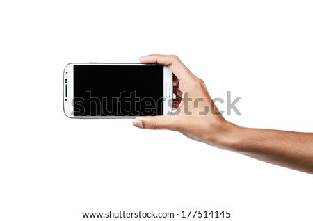Isolated female hands holding phone - stock photo