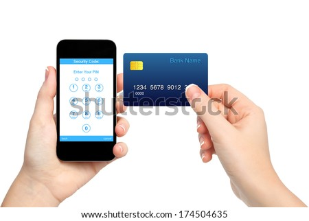 isolated female hands holding phone and credit card and enter a PIN code  - stock photo
