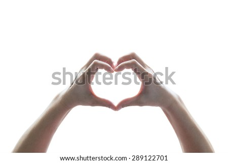 Isolated female human hands in heart shape on white background: : Universal hand sign language meaning love and caring    - stock photo