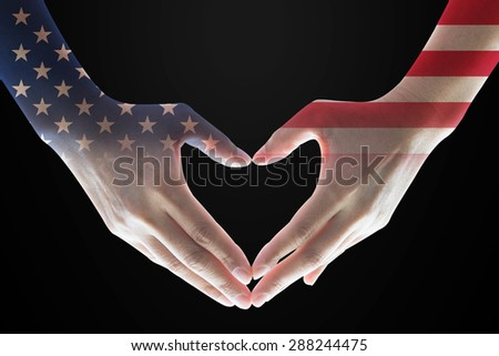 Isolated female human hands in heart shaped form with double exposure of the United States of America flag pattern on black background: USA Independence, Columbus day, Veterans day, flag day concept  - stock photo