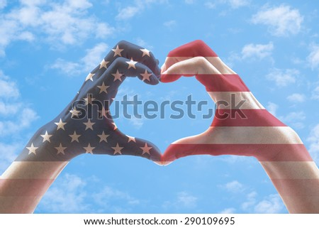 Isolated female human hands in heart shaped form with double exposure of the United States of America flag pattern on bright blue sky background with clouds : USA Independence day and flag day concept - stock photo