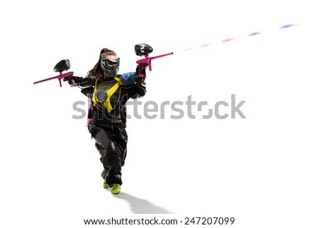 Isolated female paintball player is playing the game - stock photo