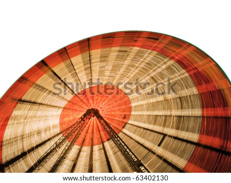 Isolated Ferris Wheel, shot with slow shutter speed. Clipping path included. Great for numerous concepts, including fun, risk, vacations, dizziness, etc! - stock photo