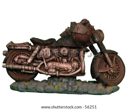 Isolated figure of an old motorcycle with a helmet hanging from the handlebars