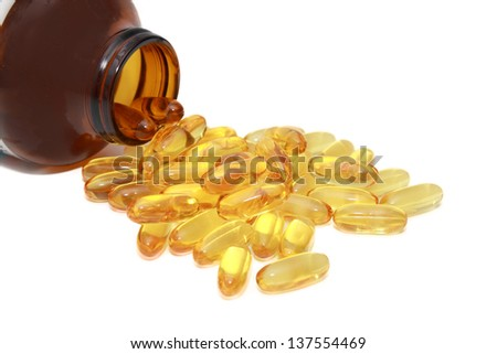 isolated fish oil from a jar - stock photo