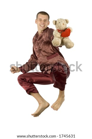 isolated flying pyjamas man with teddy bear - stock photo