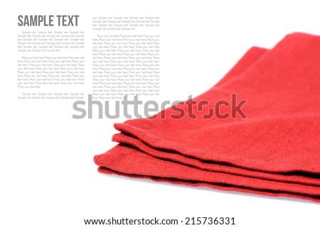 isolated folded red napkin over white background - stock photo