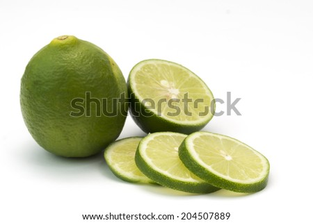 Isolated fresh lime and slices on white background