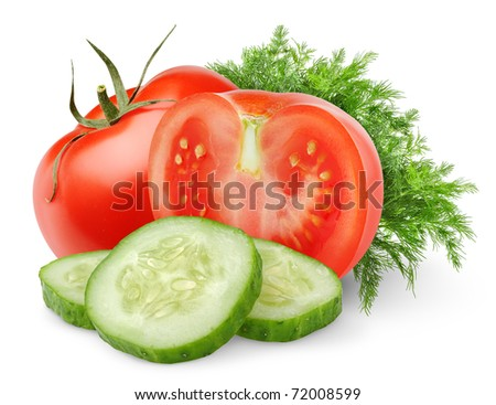 Isolated fresh vegetables. Cut tomatoes and cucumber slices (salad components) isolated on white background