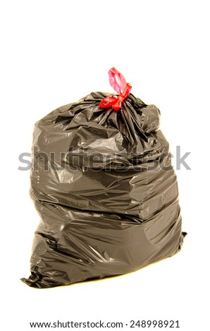 isolated full black garbage plastic bag in white background. Rubbish sack - stock photo