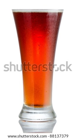 Isolated full length portrait of a full to rim cold beer in pilsner style glass with no head and partial reflection - stock photo