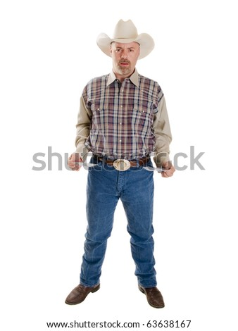 Isolated full length stock photo of a broke cowboy looking at the camera with a stunned expression and his pockets turned out. - stock photo