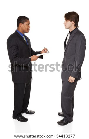 Isolated full length studio shot of a businessman answering a survey performed by another businessman. - stock photo