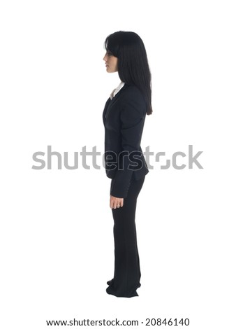 Isolated full length studio shot of a businesswoman rotating 360 degrees. - stock photo
