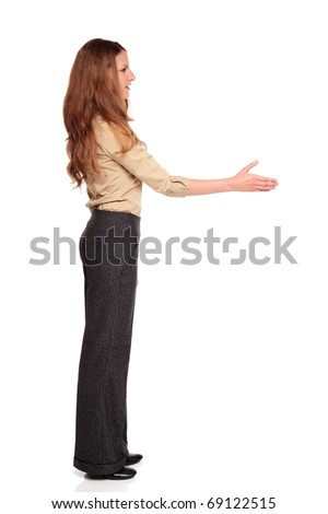 Isolated full length studio shot of a Caucasian businesswoman reaching out for a handshake.