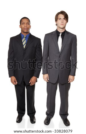 Isolated full length studio shot of a confident business team standing side by side and looking at the camera.