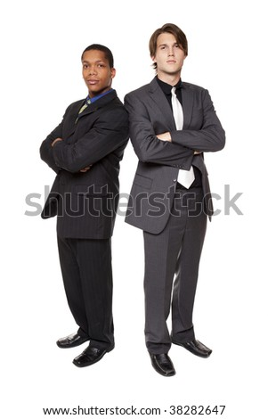 Isolated full length studio shot of a confident business team standing side by side and looking at the camera. - stock photo