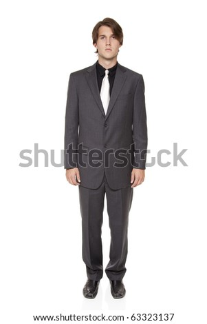 Isolated full length studio shot of a confident businessman looking at the camera. - stock photo