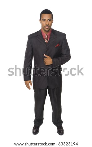 Isolated full length studio shot of a confident businessman looking at the camera.