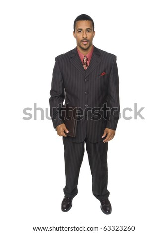 Isolated full length studio shot of a confident businessman looking at the camera while holding a notebook.