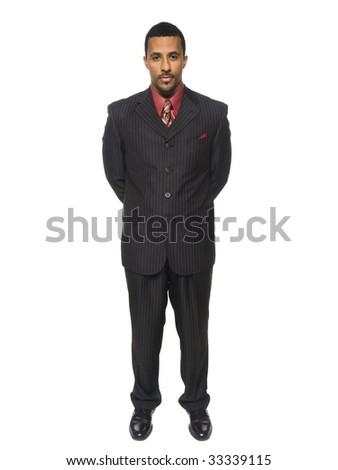 Isolated full length studio shot of a confident businessman standing and looking at the camera. - stock photo