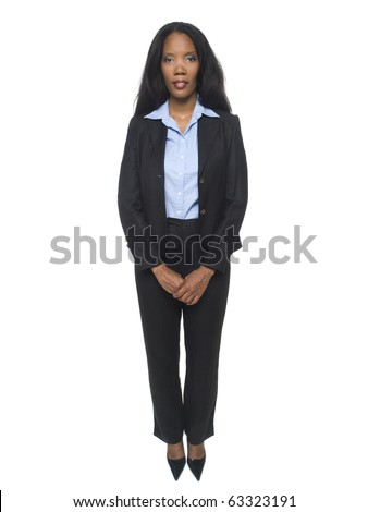 Isolated full length studio shot of a confident businesswoman standing and looking at the camera. - stock photo