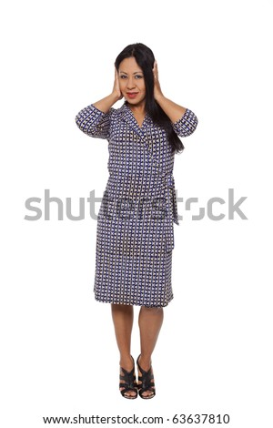 Isolated full length studio shot of a Latina woman in the Hear No Evil,  pose. - stock photo