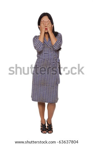 Isolated full length studio shot of a Latina woman in the See No Evil pose. - stock photo