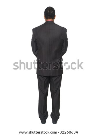 Isolated full length studio shot of an African American man looking away from the camera while clasping his hands.