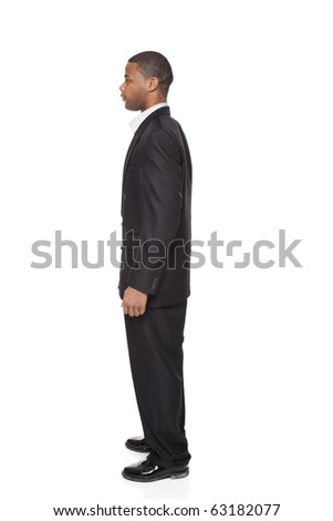 Isolated full length studio shot of side view of a tall African American businessman - stock photo