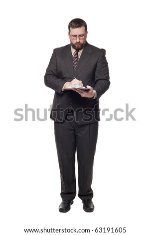 Isolated full length studio shot of the front view of a businessman writing on a clipboard.