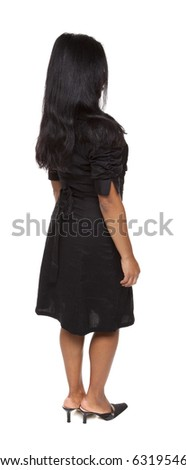 Isolated full length studio shot of the front view of a Latina woman in a dress facing away (part of a 360 rotational series) - stock photo