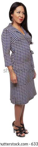 Isolated full length studio shot of the front view of a Latina woman in a dress facing forward (part of a 360 rotational series) - stock photo
