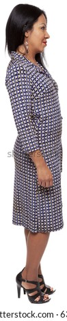Isolated full length studio shot of the front view of a Latina woman in a dress facing right (part of a 360 rotational series) - stock photo