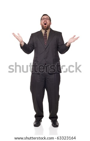 Isolated full length studio shot of the front view of an upset businessman with open mouth, raising his arms in disbelief as if giving up. - stock photo