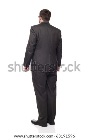 Isolated full length studio shot of the rear view of a businessman in full suit looking away from the camera.