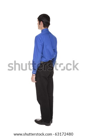 Isolated full length studio shot of the rear view of a Caucasian businessman standing with arms at sides and looking away to the left. - stock photo