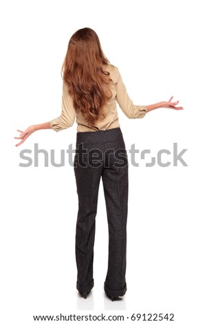 Isolated full length studio shot of the rear view of a Caucasian businesswoman looking up in disbelief with arms raised. - stock photo